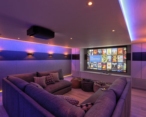 Trendy Enclosed Home Theater Photo In Kent With A Projector Screen