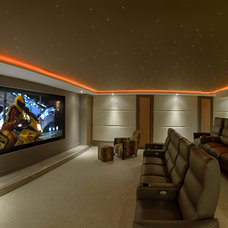 Contemporary Home Theater by Adept Integrated Systems Ltd