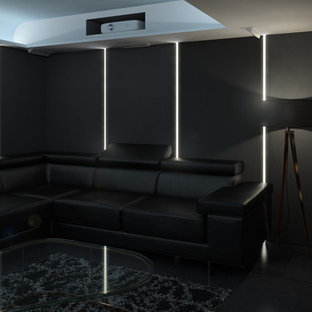Design ideas for a large modern open concept home theatre in London with grey walls, slate floors and a projector screen.