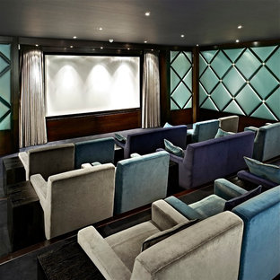 Contemporary enclosed home cinema in London with blue walls and a projector screen.