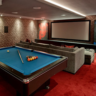 Inspiration for a contemporary open plan home cinema in London with carpet, a projector screen and red floors.