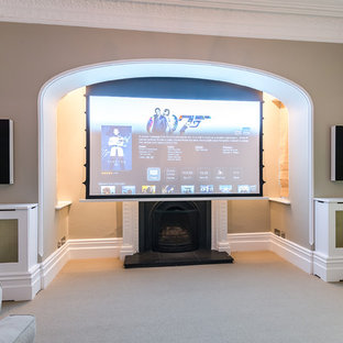 Medium sized classic enclosed home cinema in Kent with beige walls, carpet and a projector screen.