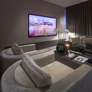 Inspiration for a large contemporary open concept home theatre in West Midlands with grey walls, ceramic floors and a projector screen.