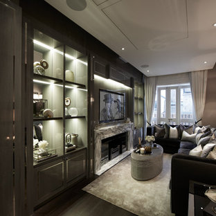 Design ideas for a contemporary home cinema in London with dark hardwood flooring and a built-in media unit.
