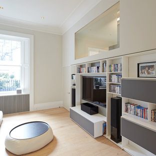 Design ideas for a medium sized contemporary enclosed home cinema in London with grey walls, light hardwood flooring and a built-in media unit.