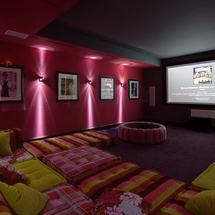 This is an example of a large contemporary enclosed home theatre in Other with pink walls, carpet, a projector screen and purple floor.