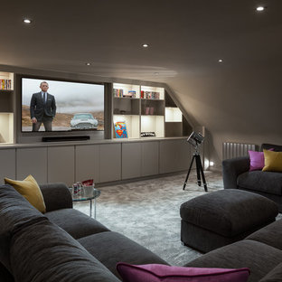 This is an example of a contemporary home cinema in Surrey.