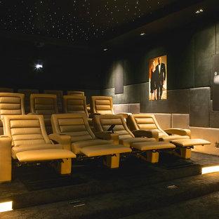Inspiration for a large contemporary enclosed home cinema in London with carpet, a projector screen, grey floors and grey walls.