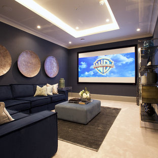Photo of a medium sized classic enclosed home cinema in Other with blue walls, carpet, a projector screen and beige floors.
