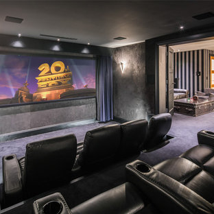 Contemporary enclosed home cinema in London with grey walls, carpet, a wall mounted tv and blue floors.