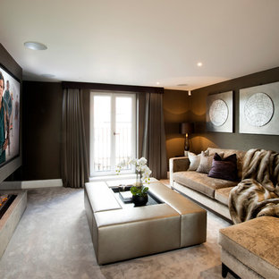 Contemporary enclosed home cinema in Manchester with grey walls, carpet, a built-in media unit and beige floors.