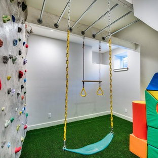Photo of a medium sized eclectic home climbing wall in Boise with white walls, carpet and green floors.