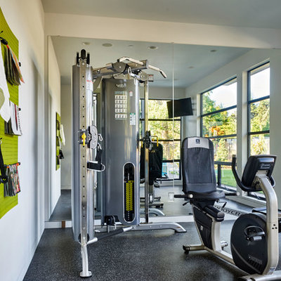 Inspiration for a large contemporary home weight room remodel in Portland with white walls