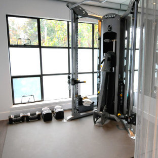 Small minimalist home weight room photo in Vancouver with white walls