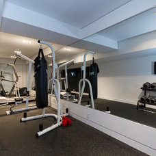 Modern Home Gym by Element Design Build Inc.
