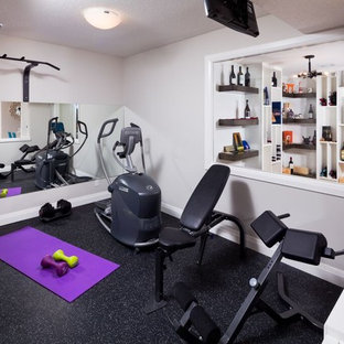 Home weight room - large home weight room idea in Calgary with white walls