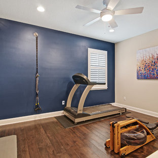 75 most popular transitional home gym with blue walls
