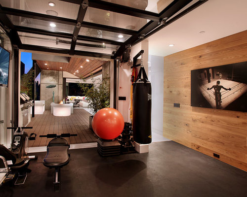 Example Of A Trendy Multiuse Home Gym Design In Orange County With Black  Floors