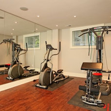 Traditional Home Gym by Foremost Construction Inc