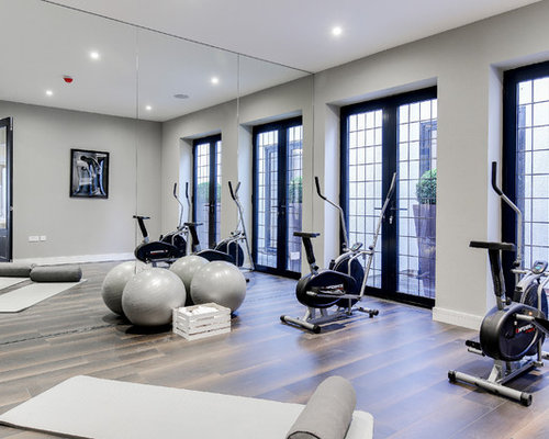 traditional home gym in hertfordshire with grey walls dark hardwood flooring and brown floors - Home Gym Design Ideas