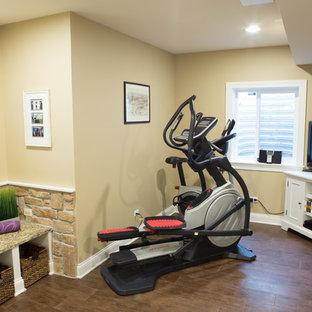 Most popular small home gym with dark hardwood flooring design