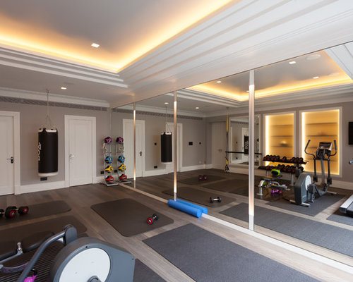 Delightful Example Of A Trendy Multiuse Home Gym Design In London With Beige Walls,  Light Hardwood