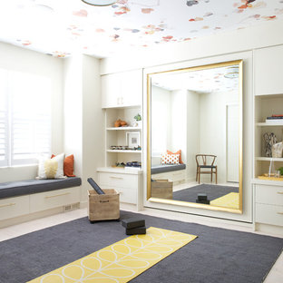This is an example of a transitional home yoga studio in Calgary with beige walls and beige floor.