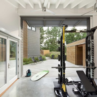 Design ideas for a coastal home gym in Philadelphia with concrete flooring, white walls and grey floors.
