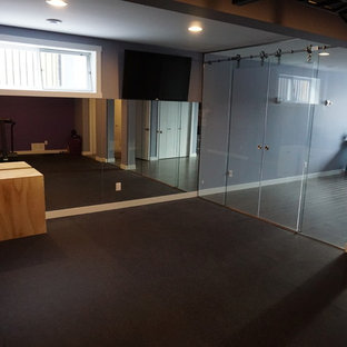 Home weight room - large modern home weight room idea in Calgary with purple walls