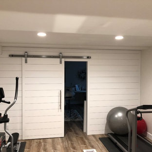Large modern multi-use home gym in Denver with limestone flooring.