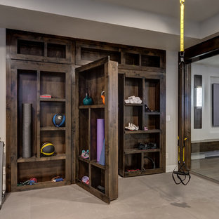Photo of a large traditional home climbing wall in Denver with grey walls and beige floors.