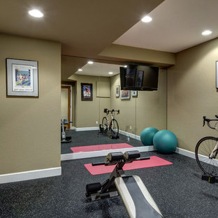 Example of a large transitional black floor multiuse home gym design in Denver with beige walls