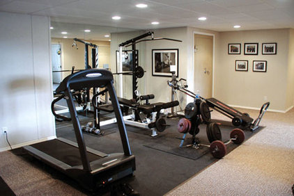 Eclectic Home Gym by Total Basement Finishing
