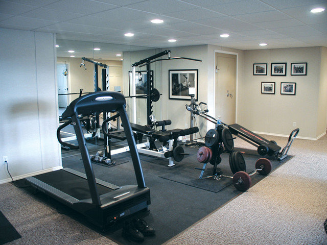 Contemporary Home Gym by Total Basement Finishing
