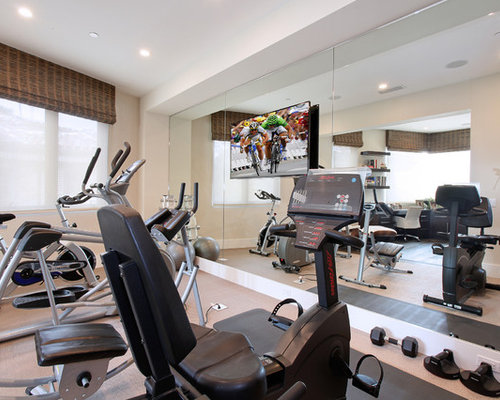 inspiration for a contemporary beige floor multiuse home gym remodel in orange county with beige walls