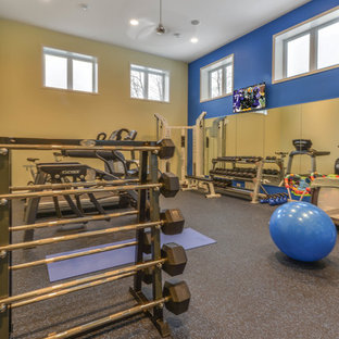 Multiuse home gym - mid-sized modern gray floor multiuse home gym idea in Minneapolis with yellow walls
