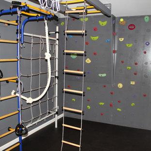 Idee per una parete da arrampicata tradizionale di medie dimensioni con pareti grigie e pavimento in sughero