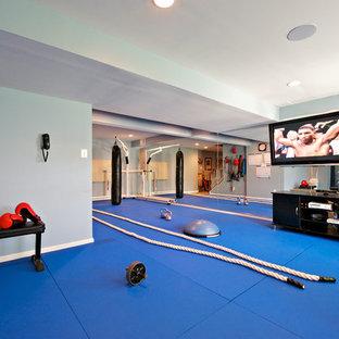 Immagine di una grande palestra multiuso chic con pareti bianche e pavimento blu