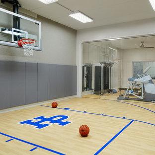 Example of a huge classic light wood floor indoor sport court design in Chicago with beige walls