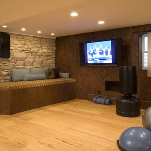 Photo of a contemporary home gym in Denver with brown walls, light hardwood flooring and orange floors.