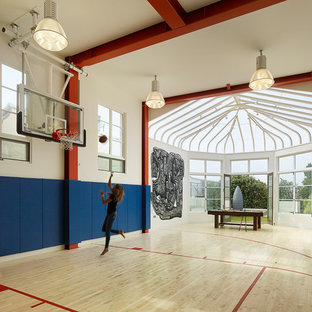 Inspiration for a large mediterranean light wood floor and beige floor indoor sport court remodel in San Francisco with white walls