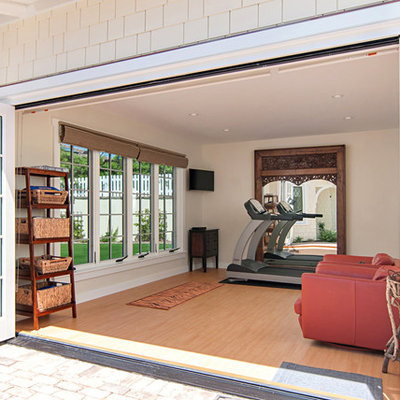 Example of a large classic vinyl floor multiuse home gym design in San Diego with beige walls