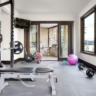 Inspiration for a mid-sized country multipurpose gym in Other with white walls and grey floor.