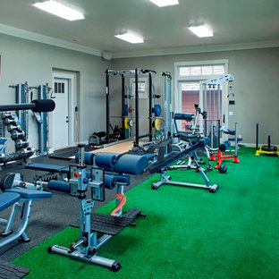 Small urban home weight room in Minneapolis with grey walls.