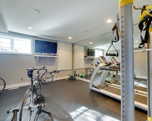 Home gym with concrete flooring and grey walls ideas