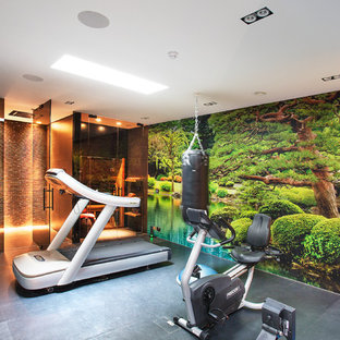 Photo of a modern multi-use home gym in London with multi-coloured walls and grey floors.