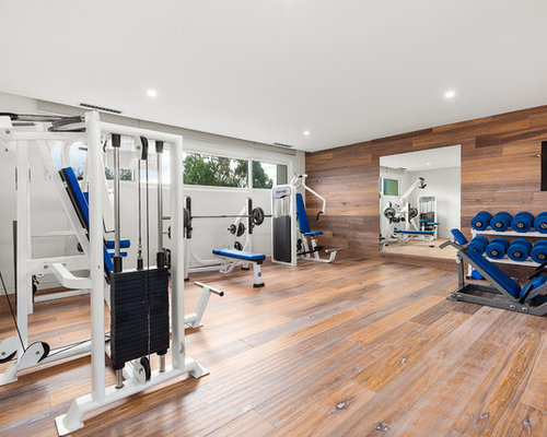 Contemporary Multipurpose Gym In Melbourne With White Walls And Dark  Hardwood Floors.