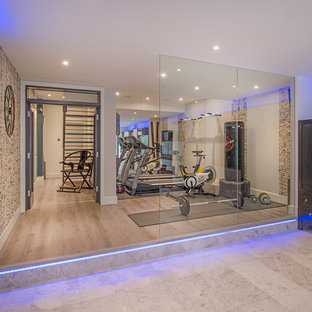 Inspiration for a medium sized contemporary multi-use home gym in London with beige walls, light hardwood flooring and beige floors.