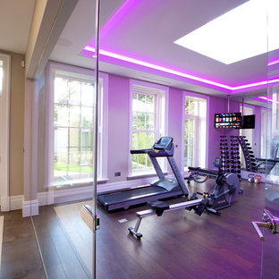 This is an example of a contemporary home gym in Cheshire with medium hardwood flooring.