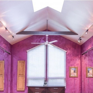 Photo of a large contemporary home yoga studio in Milwaukee with pink walls.